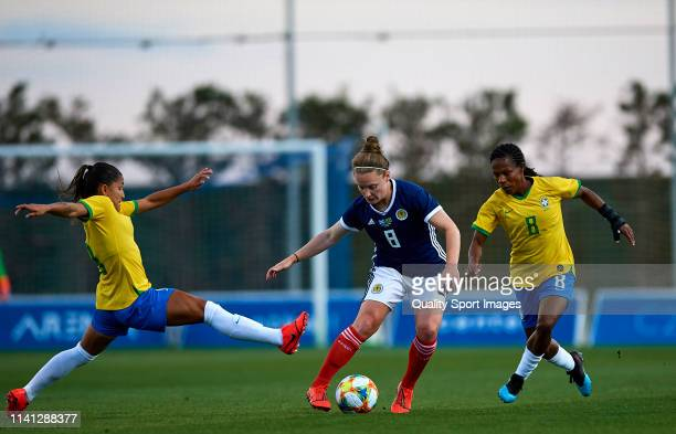 Formiga Mota and Debinha Oliveira of Brazil competes for the ball with Kim Little of Scotland during the Women's International friendly match between...