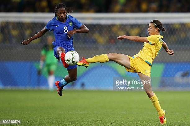 Formiga of Brasil and Katrina Gorry of Australia compete for the ball during the Women's Quarter Final match between Brasil and Australia on Day 7 of...