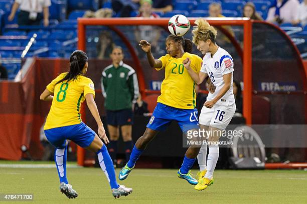 Formiga of Brazil and Kang Yumi of Korea Republic battle for the ball during the 2015 FIFA Women's World Cup Group E match at Olympic Stadium on June...