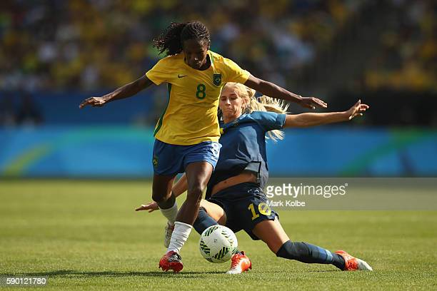 Formiga of Brazil and Sofia Jakobsson of Sweden compete for the ball during the Women's Football Semi Final between Brazil and Sweden on Day 11 of...