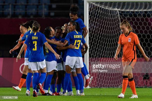 Formiga of Brazil, Andressinha of Brazil, Debinha of Brazil, players of Brazil celebrate after scoring their teams first goal during the Tokyo 2020...