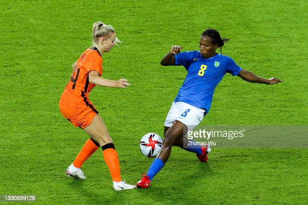 Formiga of Brazil competes for the ball with Groenen Jackie of Netherland during the Women's First Round Group F match on day one of the Tokyo 2020...