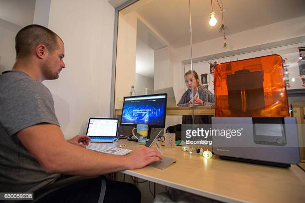 A Formlab Form 2 3D printer sits on an employee's desktop inside the offices of 3D printing and design company Formlabs GmbH in Berlin Germany on...