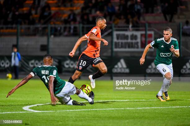 Formose Mendy of Red Star Alexis Claude Maurice of Lorient and Maxence Derrien of Red Star during the French Ligue 2 match between Red star and...