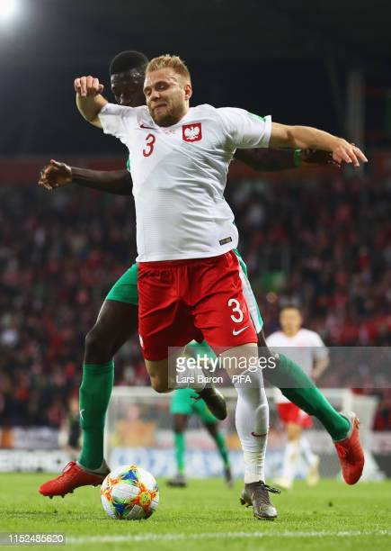 Formose Mendy of Senegal battles for the ball with Tymoteusz Puchacz of Poland during the 2019 FIFA U20 World Cup group A match between Senegal and...