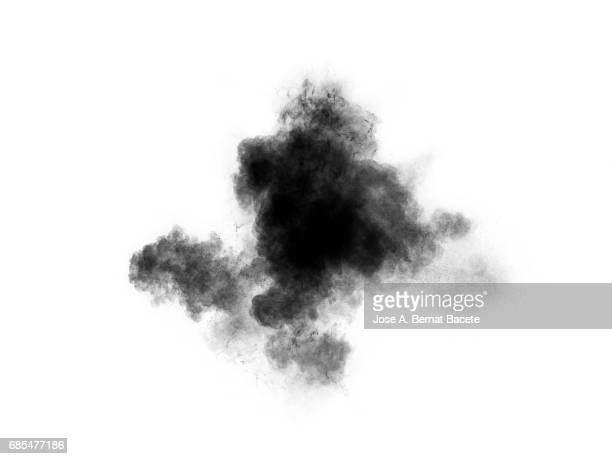Forms and textures of an explosion of a powder of color gray and black on a  white bottom