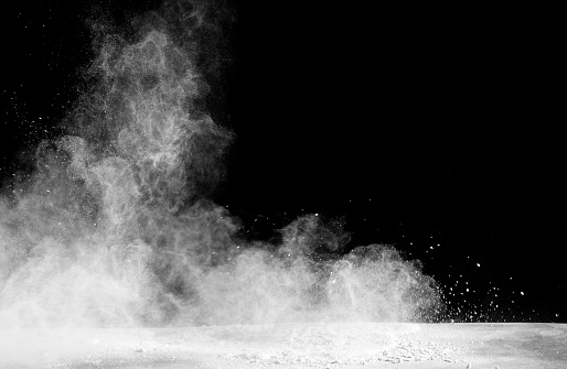 Forms and textures of an explosion of a powder of color white on a  black background - gettyimageskorea