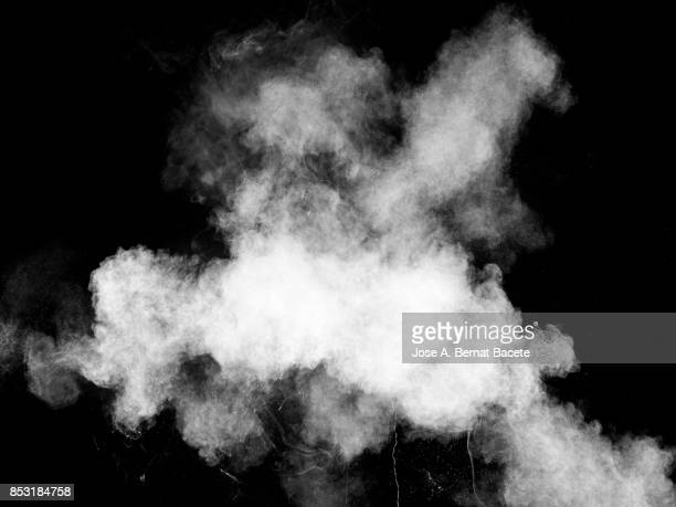 forms and textures of an explosion of a powder of color white on a  black background - food contamination stock photos and pictures