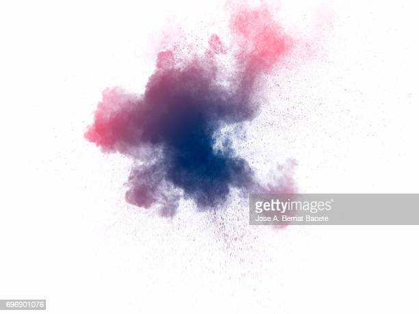 Forms and textures of an explosion of a powder of colors blue and pink on a  white background