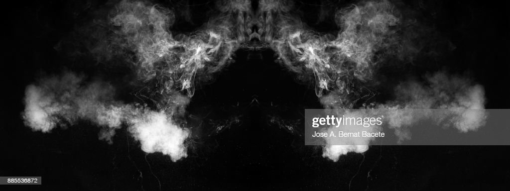Forms and textures of an explosion of smoke and powder of white color on a  black background. : Foto de stock