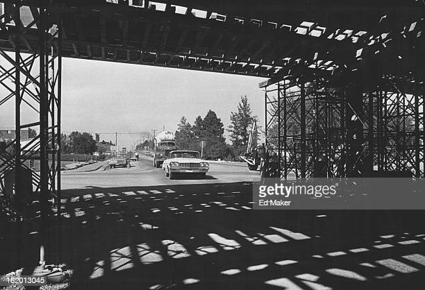 SEP 27 1965 SEP 31 1965 OCT 1 1965 Forms still remain under Interstate 70 ridge over northsouth Sheridan Blvd This view is to the north Contractor...