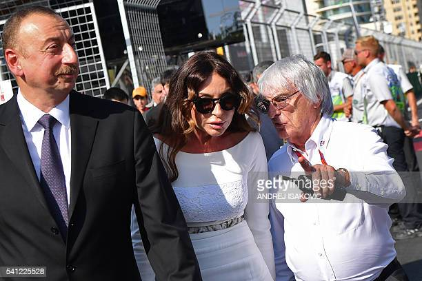 Formula 1 boss Bernie Ecclestone Azerbaijani President Ilham Aliyev and his wife Mehriban walk on the grid before the start of the European Formula...