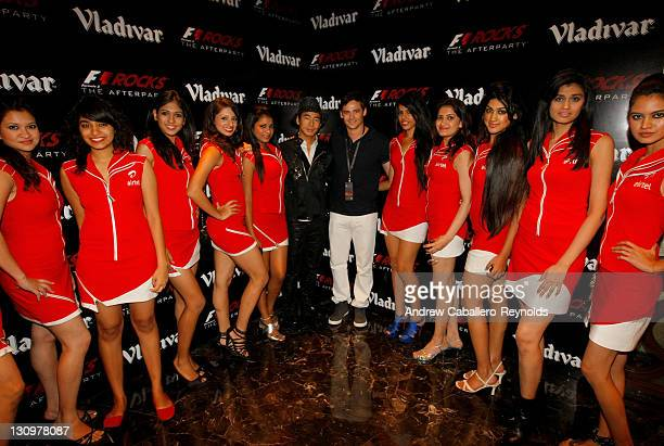 Formula 1 driver and DJ, Sakon Yamamoto,and DJ Marc Vedo pose with gird girls at the F1 Rocks India Afterparty on October 30, 2011 in Delhi, India.