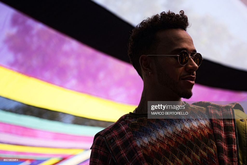 Formula 1 driver Lewis Hamilton attends the show Missoni during the Men and Women's Spring/Summer 2018 fashion shows in Milan, on September 23, 2017. / AFP PHOTO / Marco BERTORELLO