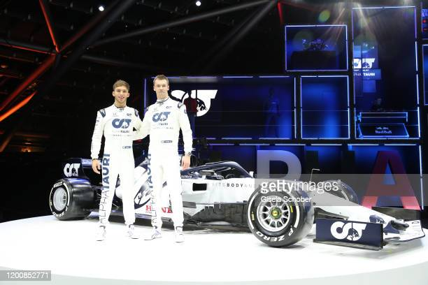 Formula 1 driver Pierre Gasly and Daniil Kvyat infront their new racing car during the Scuderia AlphaTauri launch event at Hangar 7 on February 14...