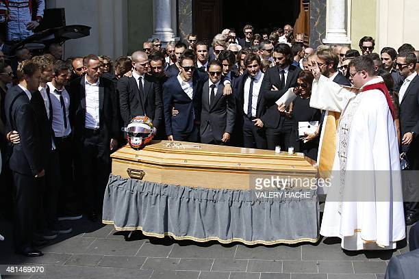 Formula 1 drivers friends and relatives stand by late French Formula 1 driver Jules Bianchi's coffin after his funeral ceremony outside Cathedrale...