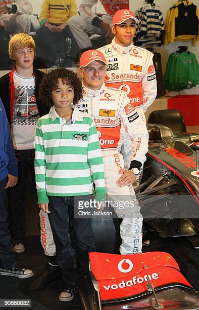 Formula 1 drivers Lewis Hamilton and Heikki Kovalainen pose for a photograph as they launch their Grand Prix-themed boyswear range, �Living the...
