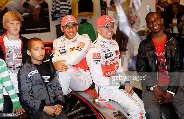 Formula 1 drivers Lewis Hamilton and Heikki Kovalainen pose for a photograph as they launch their Grand Prix-themed boyswear range 'Living the Dream'...