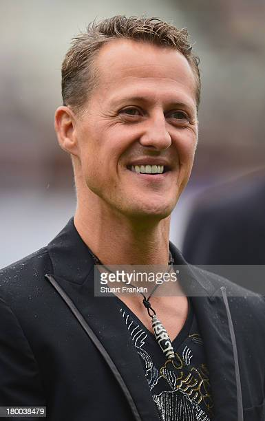 Formula 1 legend Michael Schumacher looks on during the day of the legends event at the Millentor stadium on September 8 2013 in Hamburg Germany