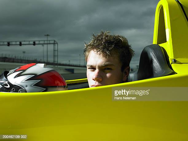 Formula 1 race car driver in seat with helmet off, portrait