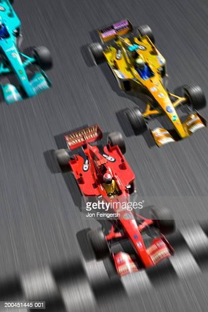 formula 1 race cars, elevated view (digital composite, blurred motion) - carrera de coches fotografías e imágenes de stock
