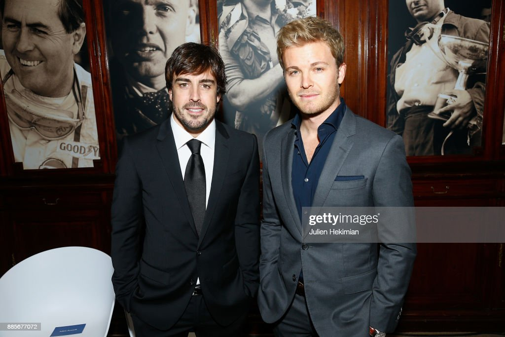 Formula 1 Word Champions Nico Rosberg (R) and Fernando Alonso attend the FIA Hall of Fame Induction ceremony at Automobile Club De France on December 4, 2017 in Paris, France.