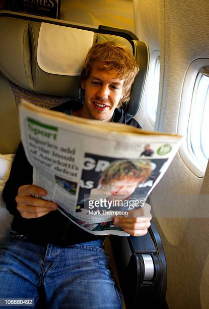 Formula 1 world champion Sebastian Vettel reads about his sentasional victory on his flight home from Abu Dhabi on November 15 2010 in Abhu Dhabi...