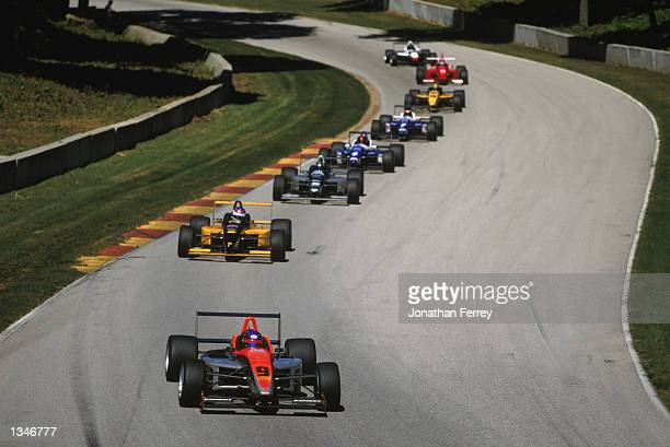 Formula Atlantic driver Roger Yasukawa leads the pack in one of the identical Reynard Dodge V6s during the Toyota Atlantic Championship Round 10 for...