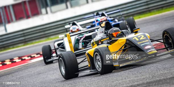 formula cars on the race track - auto racing photos stock pictures, royalty-free photos & images