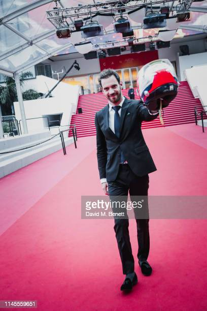 Formula E Champion JeanEric Vergne drives the Gen2 car along La Croisette ahead of the premiere of And We Go Green In Cannes on May 23 2019 in Cannes...