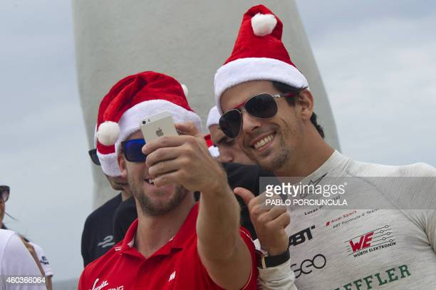 Formula E dirvers of Virgin Sam Bird and Audi Sport ABT's Lucas Grassi take a selfie before the official picture at Brava beach in Punta del Este...