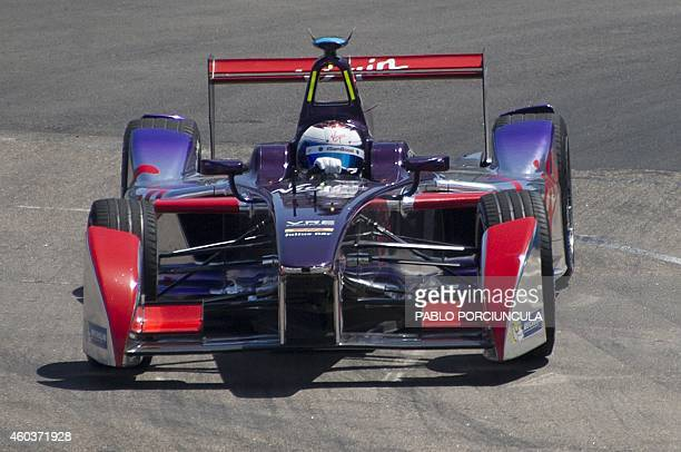 Formula E driver Virgin Racing's Sam Bird powers his cars during a complete shakedowns in Punta del Este resort some 134km east of Montevideo on...