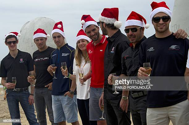 Formula E drivers pose for the official picture at Brava beach in Punta del Este resort some 134km east of Montevideo on December 12 2014 Uruguay...
