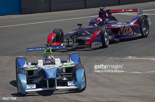 Formula E drivers Trulli's Jarno Trulli and Virgin's Sam Brid power their cars during a complete shakedowns in Punta del Este resort some 134km east...