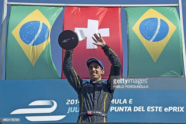 Formula E EDamsRenault Swiss driver Sebastian Buemi celebrates with the trophy after winning the Punta del Este Formula E Grand Prix in Punta del...