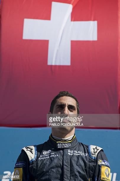 Formula E EDamsRenault Swiss driver Sebastian Buemi waits in the podium after winning the Punta del Este Formula E Grand Prix in Punta del Este...