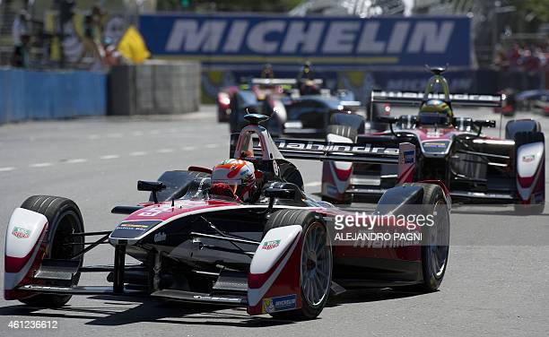 Formula E Mahindra Racing's Indian driver Karun Chandhok powers his car during the shakedown in the Formula E Buenos Aires ePrix circuit ahead of the...