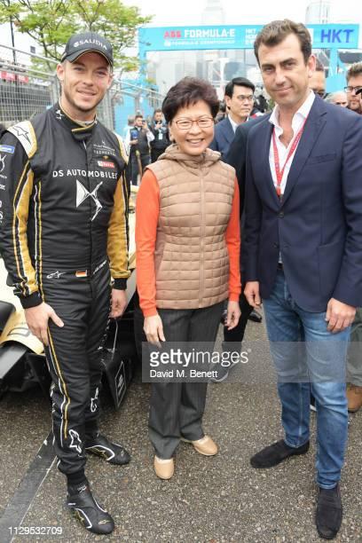 FIA Formula E racing driver Andre Lotterer Chief Executive of Hong Kong Carrie Lam and Alberto Longo attend the ABB FIA Formula E HKT Hong Kong EPrix...