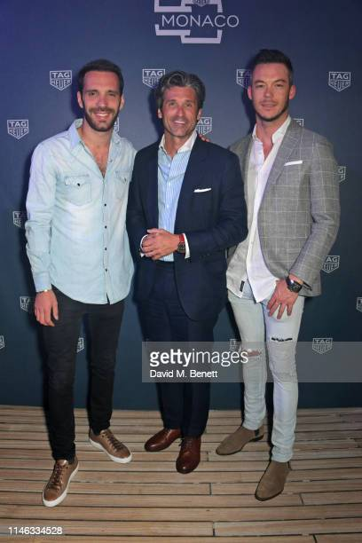Formula E racing driver JeanEric Vergne Patrick Dempsey and Formula E racing driver Andre Lotterer celebrate 50 years of the Monaco watch at the TAG...