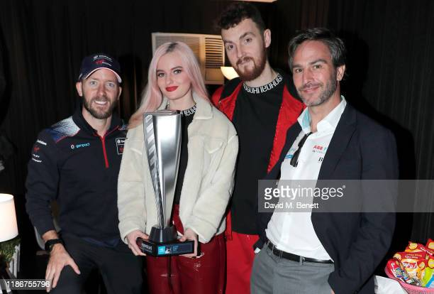 Formula E racing driver Sam Bird Grace Chatto and Jack Patterson of Clean Bandit and Formula E CEO Jamie Reigle pose backstage before the concert for...
