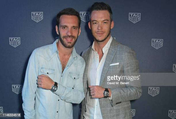 Formula E racing drivers JeanEric Vergne and Andre Lotterer celebrate 50 years of the Monaco watch at the TAG Heuer Yacht Party on May 25 2019 in...
