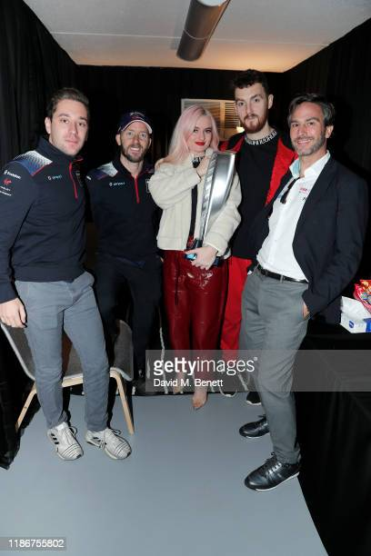 Formula E racing drivers Robin Frijns and Sam Bird Grace Chatto and Jack Patterson of Clean Bandit and Formula E CEO Jamie Reigle pose backstage...