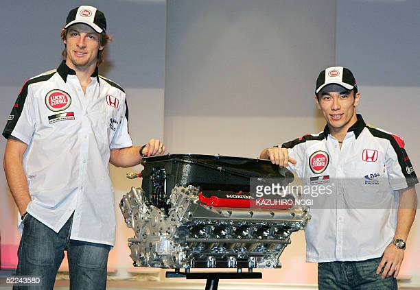 Formula One BARHonda team drivers British Jenson Button Japanese Takuma Sato pose with the new 'Honda RA005E' engine during a press conference to...