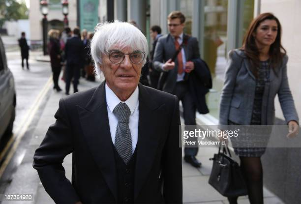 Formula One boss Bernie Ecclestone makes an unexpected departure from court with his wife Fabiana Flosi after a fire alarm cleared the Rolls Building...