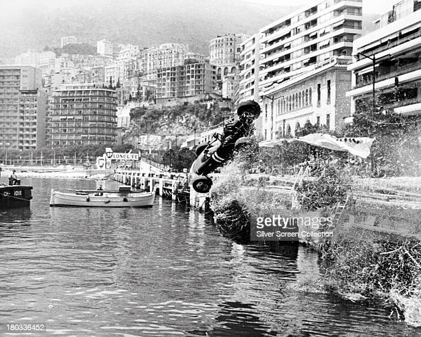 A Formula One car crashes during the Monaco Grand Prix in 'Grand Prix' directed by John Frankenheimer 1966