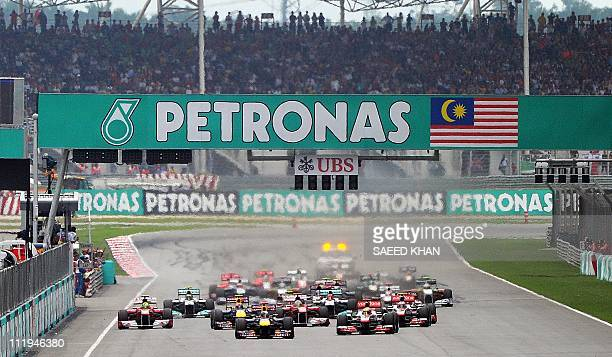 Formula One cars power down the straight at the start of Formula One's Malaysian Grand Prix in Sepang on April 10 2011 AFP PHOTO/Saeed KHAN