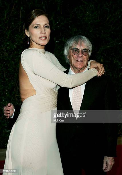 Formula One chief Bernie Ecclestone and wife Slavica arrive at the Laureus/Vogue welcome party on May 15 2005 at Farol Design Hotel Estoril Portugal