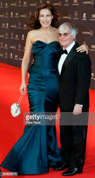 Formula One chief Bernie Ecclestone and wife Slavica arrive at the Laureus World Sports Awards on May 16 2005 at the Estoril Casino Estoril Portugal