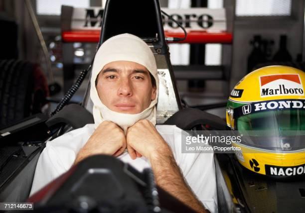 Formula One driver Ayrton Senna of Brazil pictured sitting in the driver's seat of his Honda Marlboro McLaren McLaren MP4/6 Honda RA121E 35 V12...