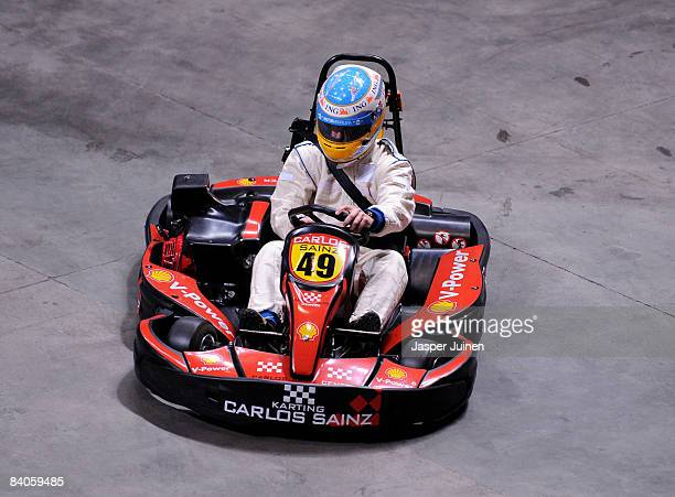 Formula one driver Fernando Alonso steers his kart during the 'Iker Vs Rafa' charity game at the Palacio de Deportes de la Comunidad de Madrid on...
